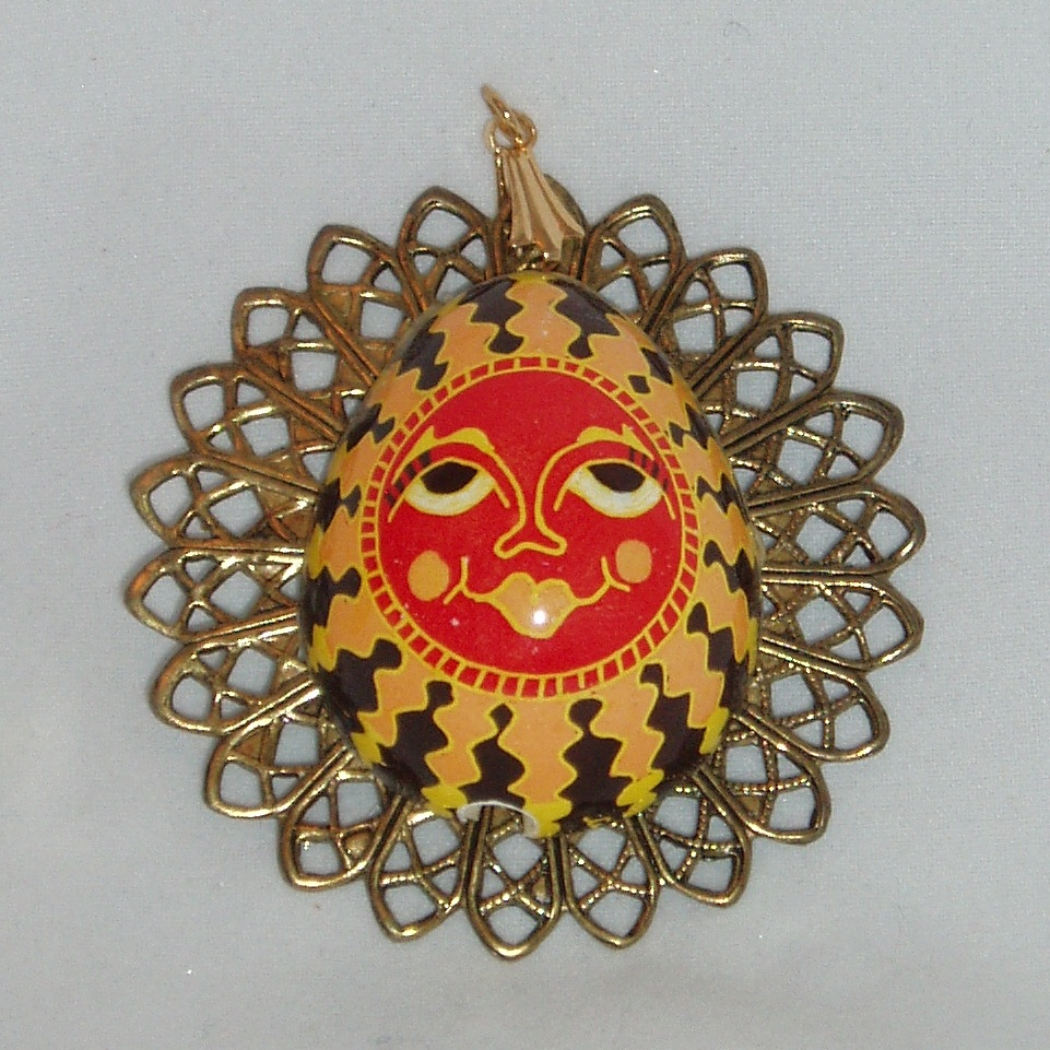 Sun Pendant red-faced